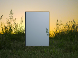 White frame in a green field on the sunset