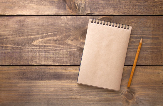 Blank vintage paper notebook with pencil