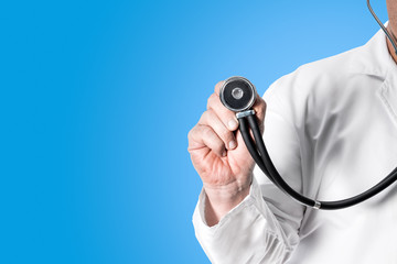 Doctor holding stethoscope in hand