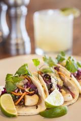 halibut tacos with avocado salsa verde and a margarita