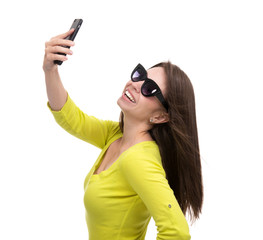 Young pretty girl in sunglasses make self portrait selfie with h