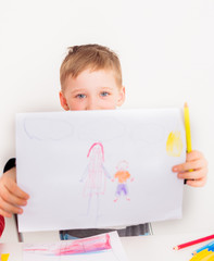 Child showing picture with mother and son