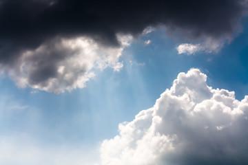 A rays of light shining throug dark clouds