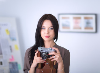 Woman is a proffessional photographer with camera.