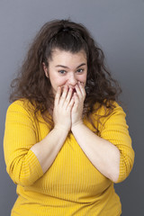shy young big woman touching her face for wellness