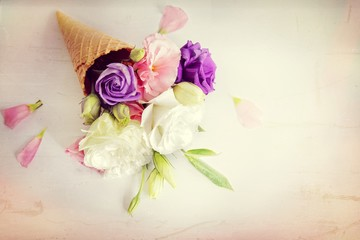 Fresh flowers in ice cream cone in vintage style