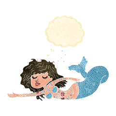 cartoon mermaid covered in tattoos with thought bubble