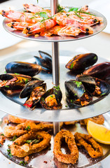 tray of assorted seafood, prawns, mussels, calamari,close up
