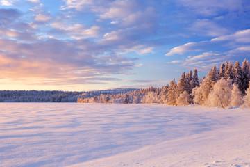 Wall Mural - Frozen Äijäjärvi lake in Finnish Lapland in winter at sunset