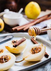 add honey to a pear with walnuts, cinnamon sticks, cooking proce
