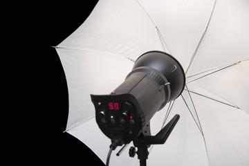 photography studio strobe flash with white umbrella and black co