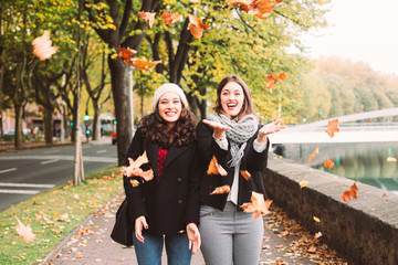 Urban funny girls enjoying autumn