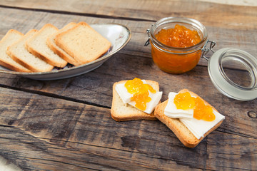 Fresh breakfast with toast and marmalade. Wooden background. Rustic style.