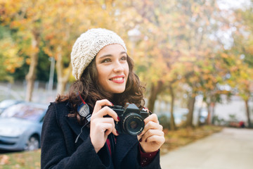 Beautiful photographer woman in autumn