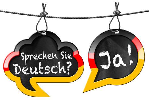 Sprechen Sie Deutsch - Speech Bubbles / Two speech bubbles with German flag and text Sprechen Sie Deutsch? Ja! (Do you speak German? Yes!). Isolated on white