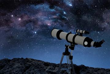 telescope on rocky ground observing a starry night sky