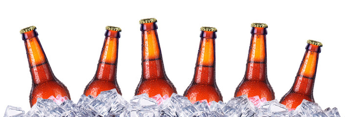 Set of beer's bottles with frosty drops in ice
