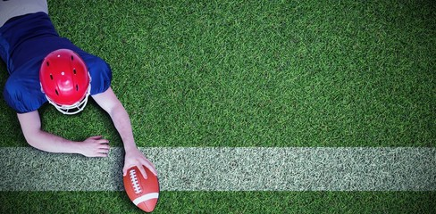 Composite image of american football player scoring a touchdown Wall mural