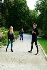 Love triangle in Vilnius town Bernardinu garden on autumn