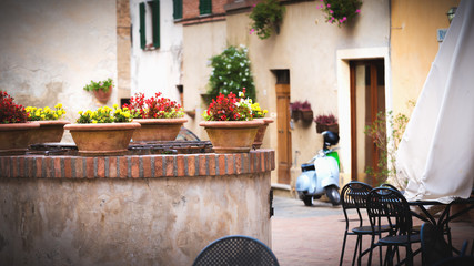 Square in front of the buildings in the medieval town in Tuscany