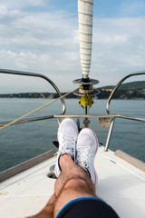 white sailing shoes on deck of a sailing boat