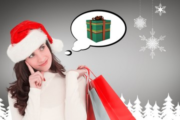 Composite image of brunette holding shopping bags
