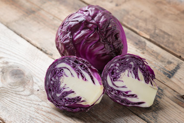 Red cabbage on a wood background..