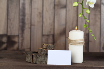 Orchid  and candle on wood background