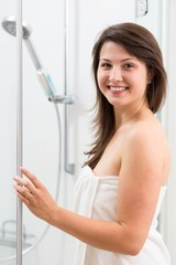 Smiling woman in shower cabin
