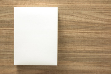 A empty(blank) white box on the desk(table) top view at the studio.