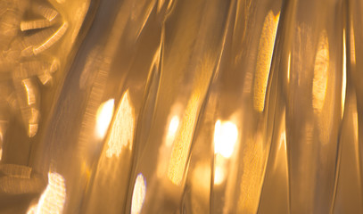 Fotobehang - lights reflection on golden metallic background