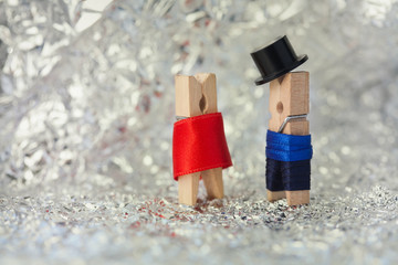 Clothespins: abstract romantic couple. Gentleman in black hat, woman in red dress