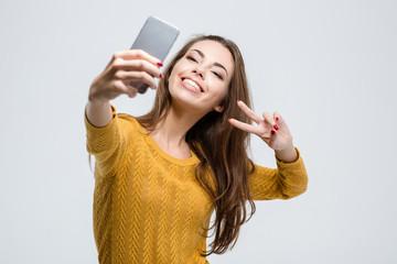 Cute woman making selfie photo