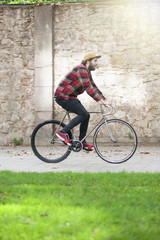 Hipster young boy riding his bike