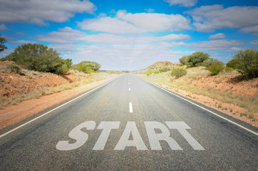 Conceptual Image of a Straight Road with the word Start on Asphalt