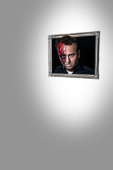 Halloween Two-Face Zipper Face in a photo frame. Background white