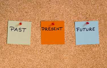 Past, present, future concept. Memo notes pinned on a cork board