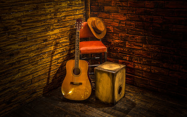 Acoustic instruments on small stage in bar