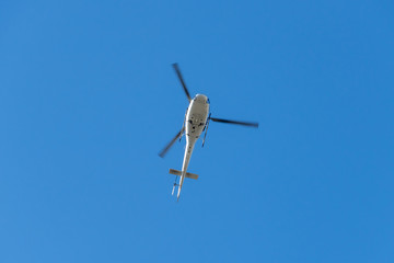 Helicopter in front of blue Sky