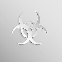 Biohazard sign light on light grey background