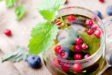 Herbal tea with fresh berries. Romantic autumn, summer background.