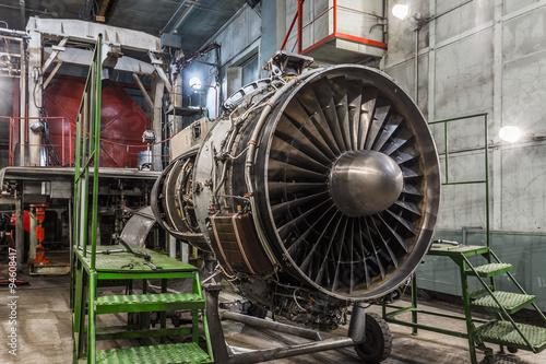 Wall mural Airplane gas turbine engine detail in hangar