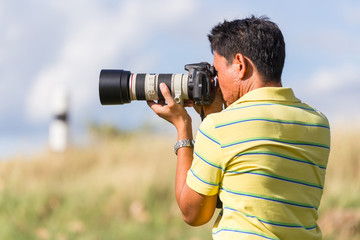 Thai photographer or traveller using a professional DSLR camera