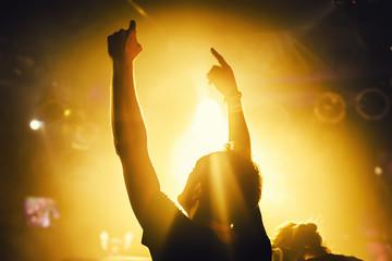 dj hands up in night club festival