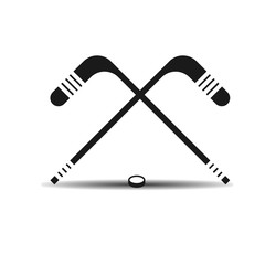 Vector icon hockey sticks and a puck with shadow