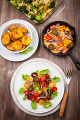 Tomato salad with grilled cheese and baked potatoes
