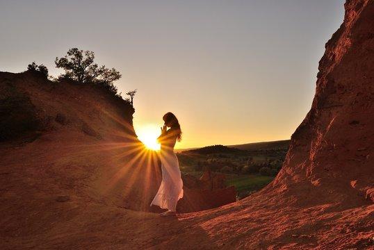 Woman in prayer in the sun, Colorado provencal, rustrel, France