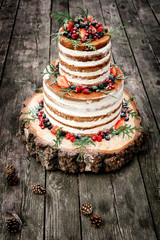 wedding cake in rustic style with berries