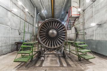 Wall Mural - Turbojet of aircraft in aviation hangar