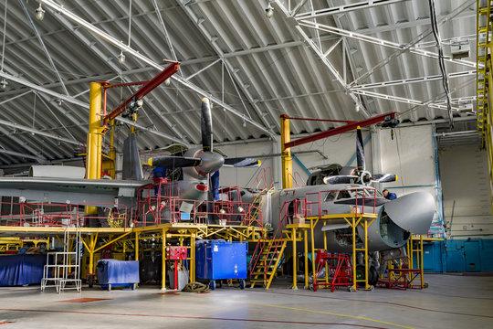 Inside aerospace hangar stand airplane
